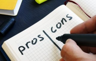 man writing list of pros and cons