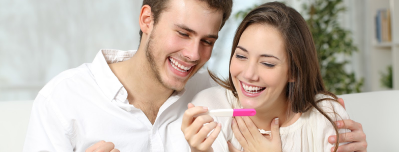 happy couple positive pregnancy test